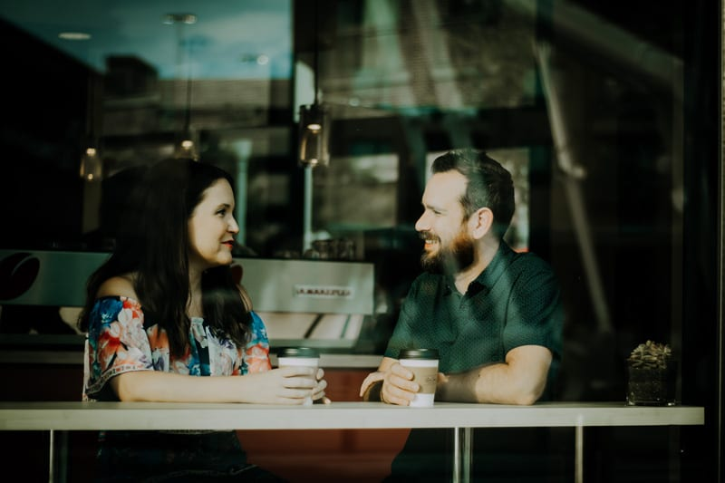 Photo of a man and a woman talking at a table